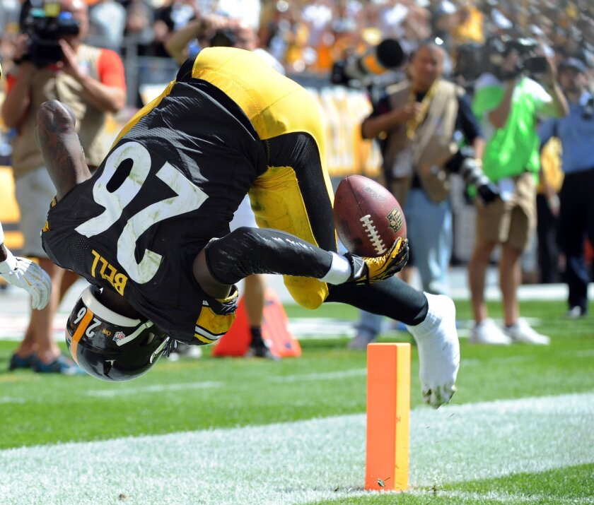 Pittsburgh Steelers running back Le'Veon Bell (26) tumbles onto the end zone scoring a touchdown against the Cleveland Browns in the second quarter of the NFL football game on Sunday, Sept. 7, 2014, in Pittsburgh. (AP Photo/Don Wright)