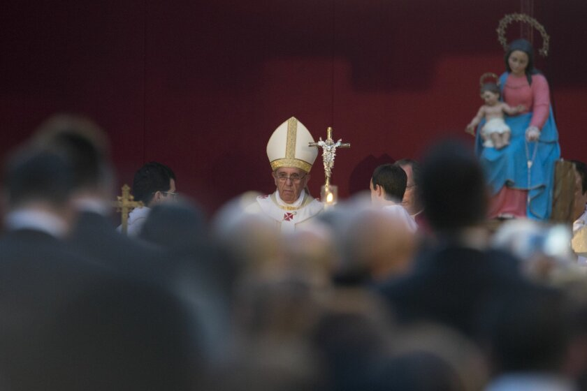 Pope Francis celebrates Mass at Rome's Verano cemetery, on the occasion of All Saints Day festivity, Friday, Nov. 1, 2013. (AP Photo/Andrew Medichini)