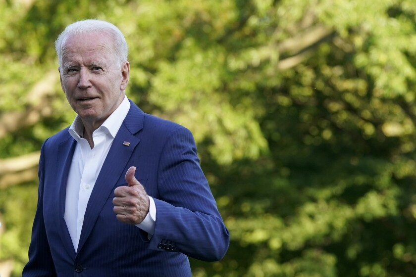 President Biden gives a thumb's up.