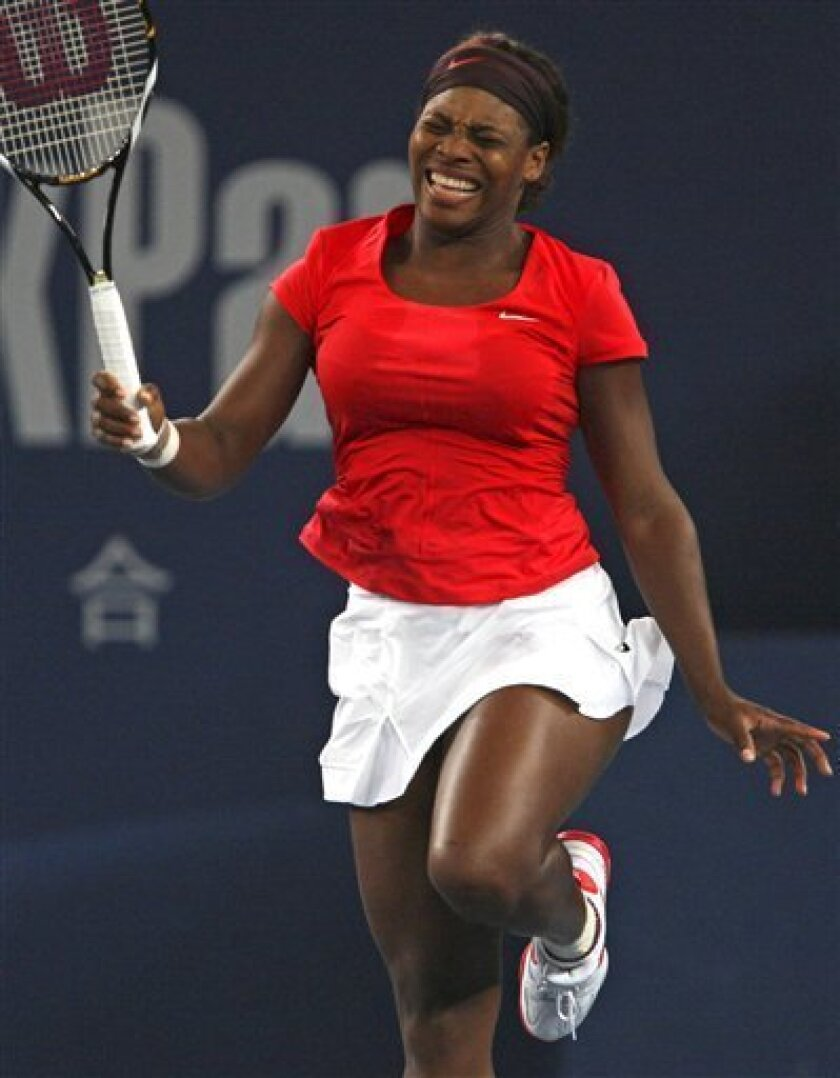 Serena Williams of the United States reacts after loosing a point to Russia's Nadia Petrova during their third round match of the China Open tennis tournament in Beijing Thursday, Oct. 8, 2009. Petrova won the match 6-4, 3-3,7-6. (AP Photo/Elizabeth Dalziel)