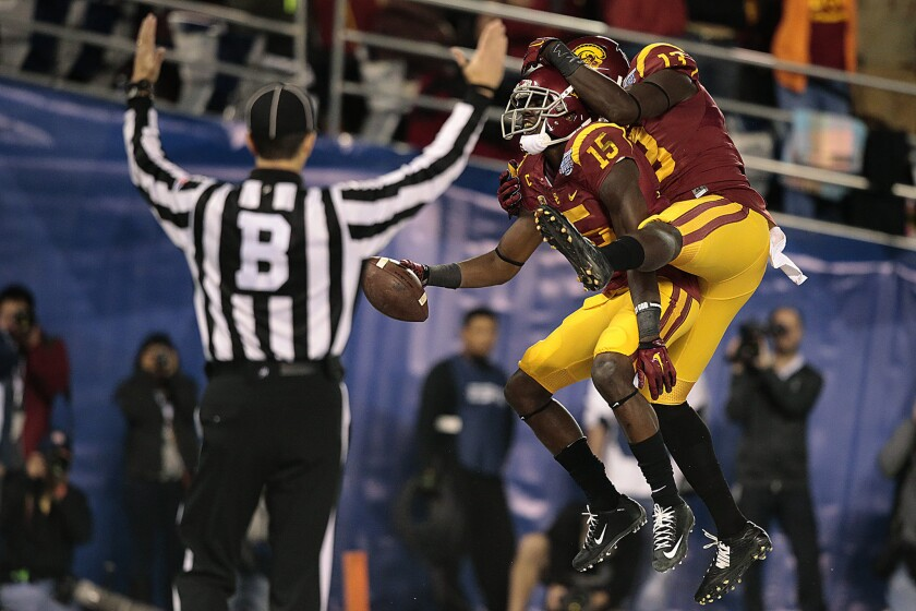USC receiver Nelson Agholor (15) celebrates with teammate Bryce Dixon after scoring on a 17-yard reception in the second quarter.