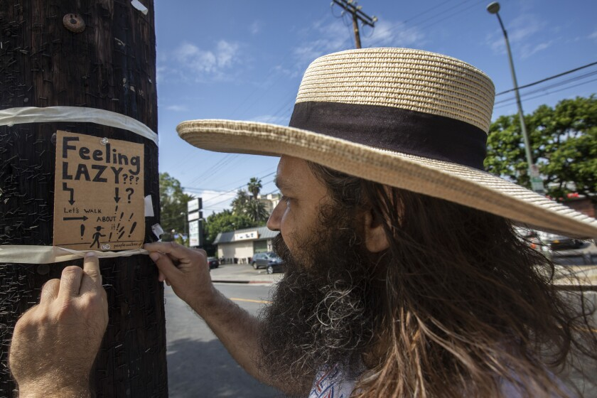 Chuck McCarthy's handmade signs drew attention to his burgeoning people-walking business.