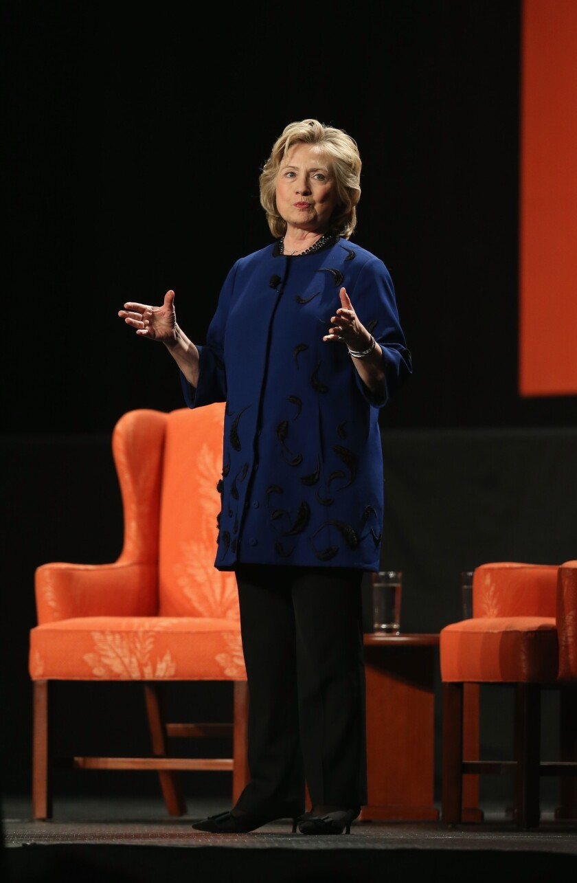At a Wednesday night stop in Coral Gables, Fla., Hillary Rodham Clinton revealed nothing about her future plans. But she did offer a glimpse of some possible themes in a 2016 run for president.