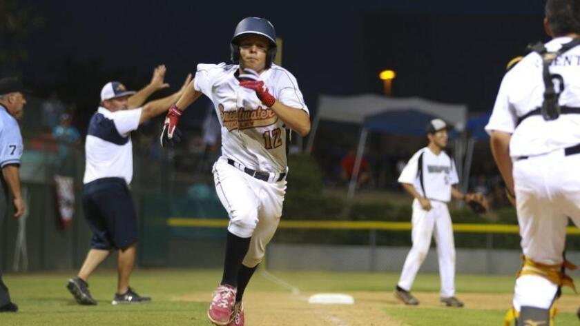 Sweetwater Valley's Levi Mendez charges home with a run against Hawaii on Saturday night. (Nelvin C. Cepeda)