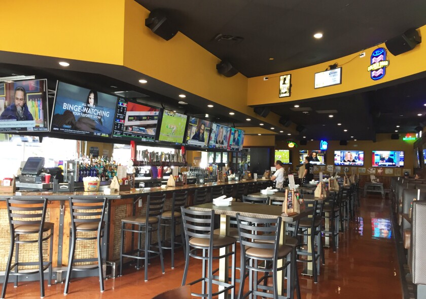 Interior of the new Cold Beers & Cheeseburgers sports pub restaurant that opened Oct. 29 in Carlsbad Village.