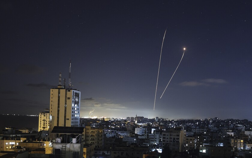 A streak of light appears as Israel's Iron Dome anti-missile system intercepts rockets launched from the Gaza Strip.