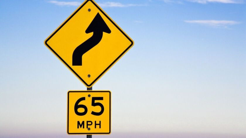 yellow directional jog 65mph road sign