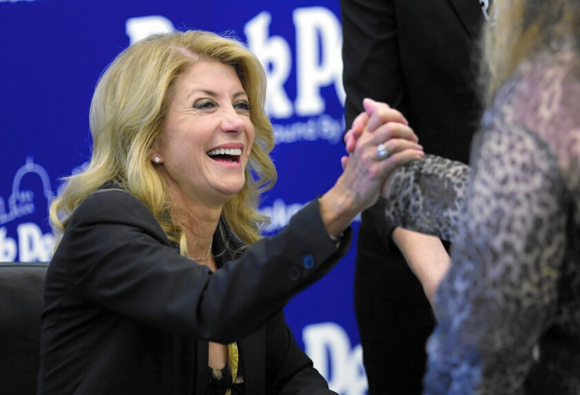 Texas Democratic gubernatorial candidate Wendy Davis campaigning in September. She won national attention after an 11-hour filibuster to block anti-abortion legislation in the Texas Senate.