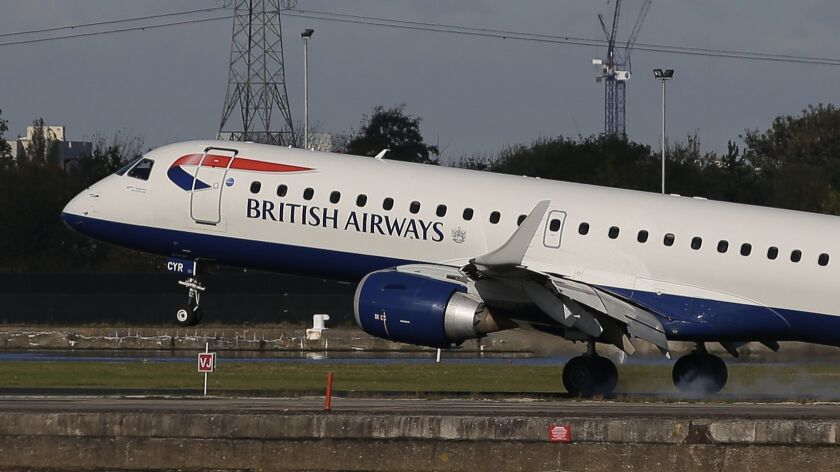 A British Airways E190 Embraer airplane lands at London City Airport.
