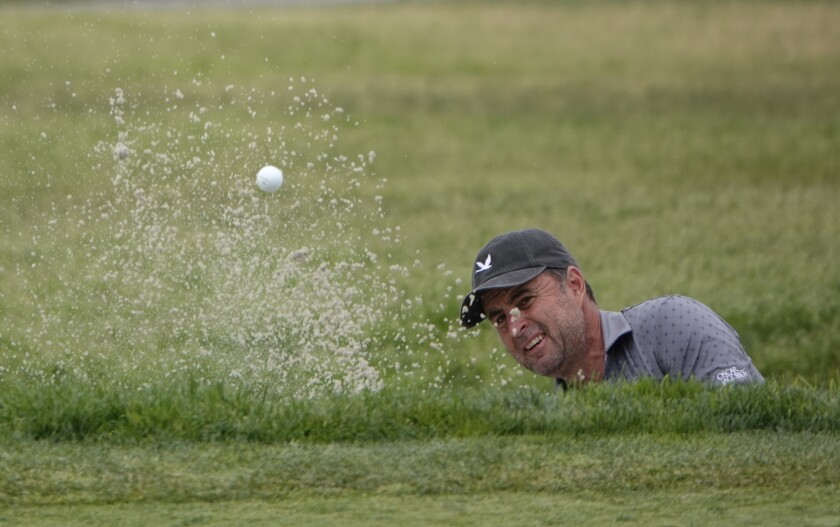 England's 48-year-old Richard Bland hits out of the sand on the eighth hole during the second round of the U.S. Open.