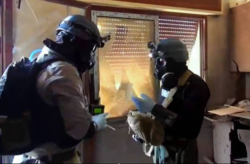 U.N. weapons inspectors are reportedly shown collecting samples last month during their investigations in Zamalka, east of Damascus, in an image provided by the Local Committee of Arbeen.