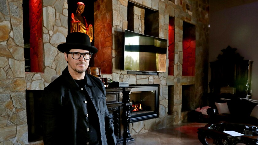 """It puts my soul at ease and calibrates me but at the same time looks like a vampire lair,"" the host of ""Ghost Adventures"" says of his living room."
