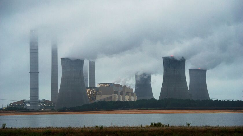 The coal-fired Plant Scherer is shown in operation early Sunday, June 1, 2014, in Juliette, Ga. The