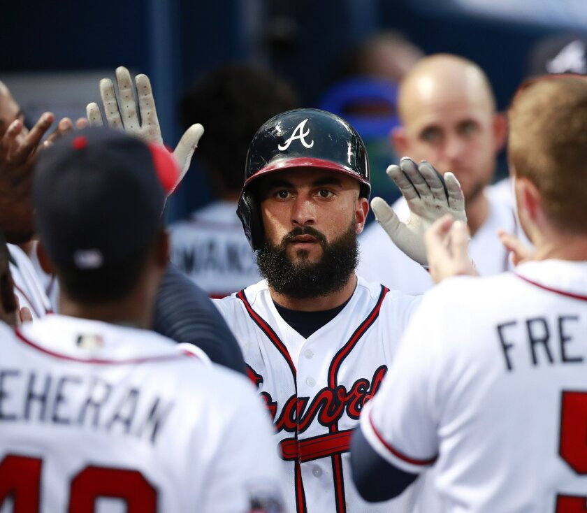 CORRECTS YEAR Atlanta Braves right fielder Nick Markakis (22) celebrates after hitting solo-home run in the second inning of a baseball game against the Miami Marlins in Atlanta, on Monday, Sept 12, 2016. (AP Photo/John Bazemore)