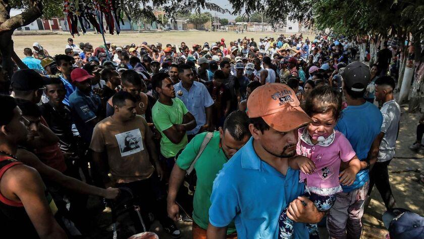 Venezuelan migrants gather outside La Divina Pastora shelter in Villa del Rosario, Colombia, on Feb. 13, 2019.