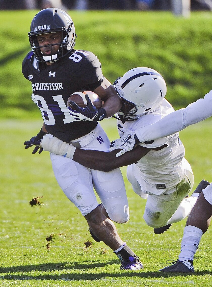 Penn State safety Malik Golden (6) tackles Northwestern wide receiver Jelani Roberts (81) during the second half of an NCAA college football game in Evanston, Ill.,  Saturday, Nov. 7, 2015. (AP Photo/Matt Marton)