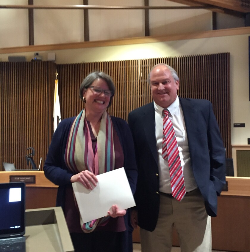 Del Mar Mayor Ellie Haviland presented outgoing City Manager Scott Huth with a proclamation during his last meeting on Feb. 3.