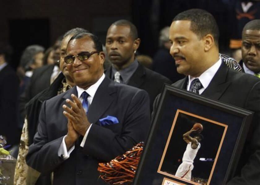 FILE - In this March 2, 2011, Nation of Islam Minister Louis Farrakhan, left, and his son Mustapha Farrakhan, are seen during ceremonies honoring Virginia seniors, including Mustapha's son, at an NCAA college basketball game in Charlottesville, Va.  A state law enforcement agency is investigating M