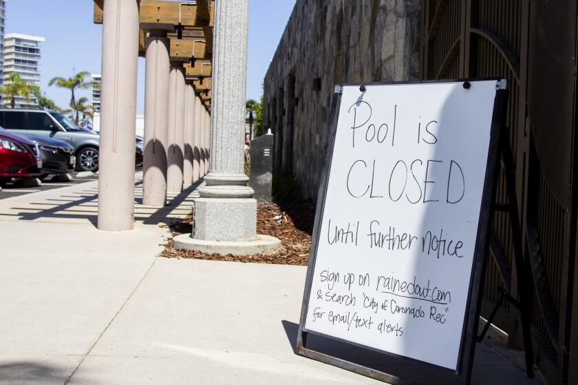 A sign announces pool closure