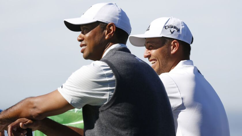 Tiger Woods and Xander Schauffele talk while waiting to play on the 3rd hole of Torrey Pines south course during the first round of the Farmers Insurance Open on Jan. 24, 2019. (Photo by K.C. Alfred/San Diego Union-Tribune)