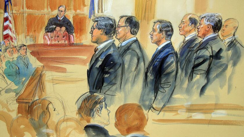 A courtroom sketch depicts Paul Manafort, fourth from right, standing with his lawyers in front of U.S. District Judge T.S. Ellis III, center rear, and the selected jury, seated left, on the first day of his trial in Alexandria, Va.