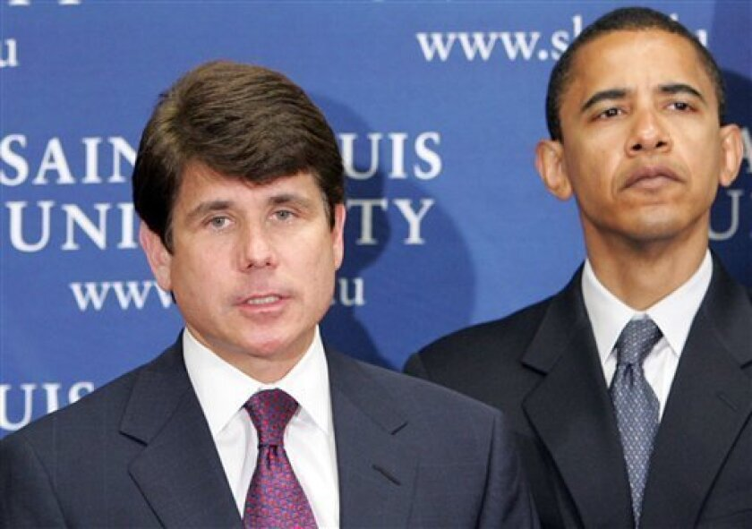 In this June 20, 2005 file photo, Gov. Rod Blagojevich, D-Ill., speaks as Sen. Barack Obama, D-Ill., listens during a news conference in St. Louis. Federal authorities arrested Blagojevich Tuesday Dec. 9, 2008 on charges that he brazenly conspired to sell or trade the U.S. Senate seat left vacant by President-elect Barack Obama to the highest bidder. (AP Photo/James A. Finley, File)