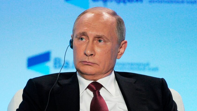 """Russian President Vladimir Putin has denied that Moscow tampered with the U.S. election, rejecting as """"utter nonsense"""" the notion that the Kremlin favored Trump."""