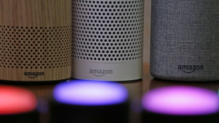 FILE - In this Wednesday, Sept. 27, 2017, file photo, Amazon Echo and Echo Plus devices, behind, sit