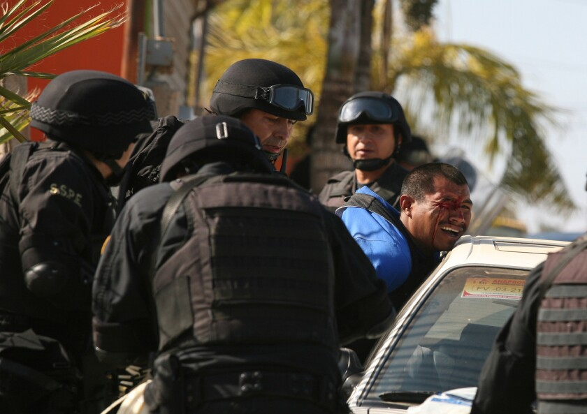 A man is detained by police Saturday after workers of tomato farm labor camps allegedly invaded private property, according to state police in San Quintin, Mexico.