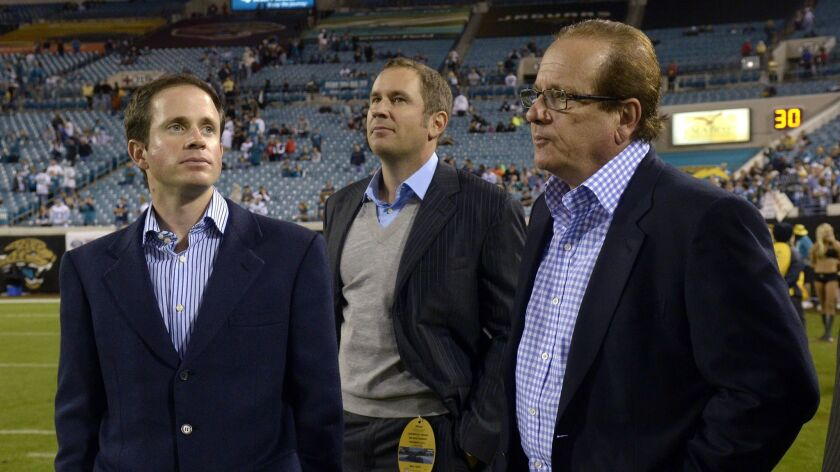 San Diego Chargers Chairman Dean Spanos, right, and sons John Spanos, left, and A.G. Spanos, watch a game in Jacksonville, Fla, in 2011.