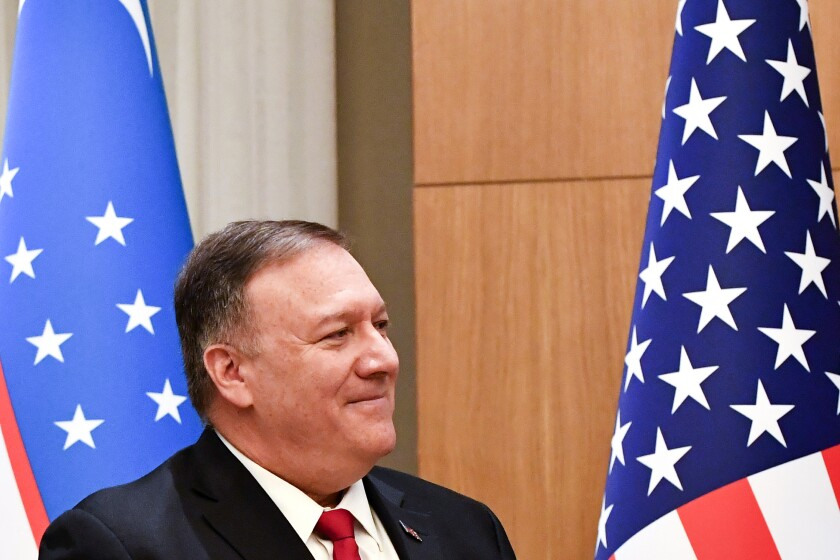 U.S. Secretary of State Mike Pompeo stands in front of Uzbek and American national flags after a joint news conference with Uzbekistan's Foreign Minister Abdulaziz Kamilov following the talks in Tashkent, Uzbekistan, Monday, Feb. 3, 2020. (AP Photo)
