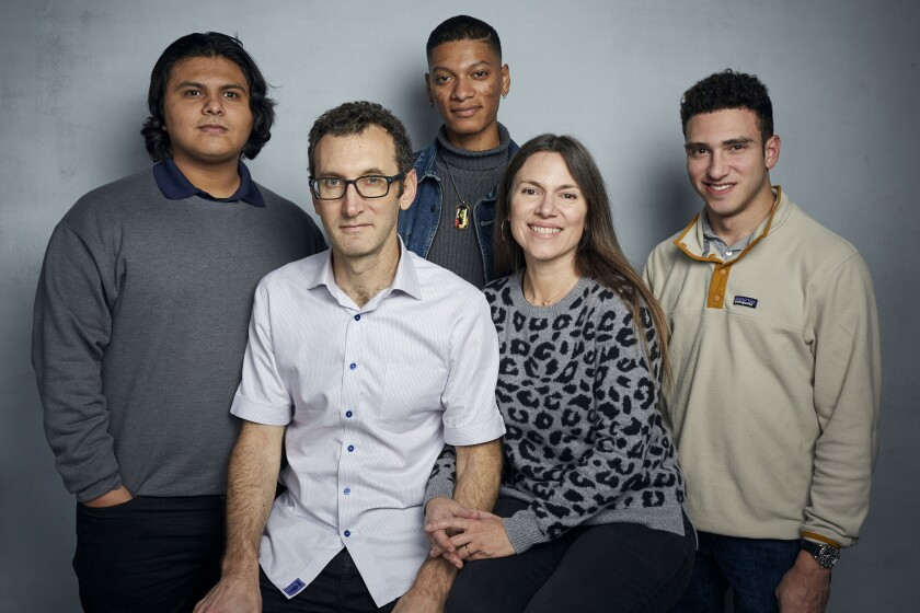 """FILE - Steven Garza, from left, director Jesse Moss, Rene Otero, director Amanda McBaine and Ben Feinstein pose for a portrait to promote the film """"Boys State"""" during the Sundance Film Festival in Park City, Utah on Jan. 24, 2020. In the documentary, directors Moss and McBaine attend a week-long program in Austin, Texas, where 1,100 high school boys attempt to build a mock government. (Photo by Taylor Jewell/Invision/AP, File)"""