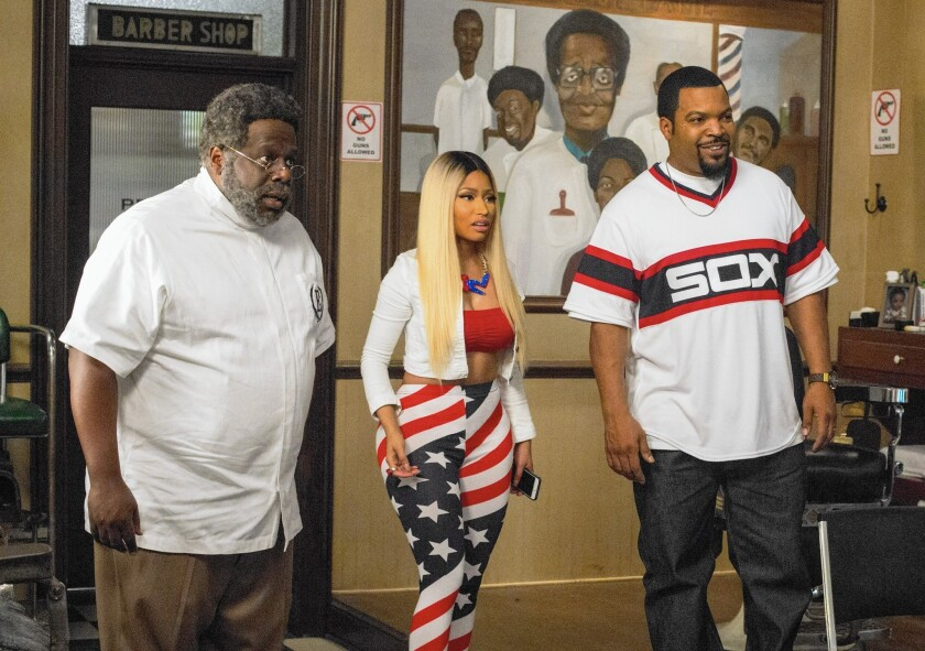 "Cedric the Entertainer, left, Nicki Minaj and Ice Cube star in ""Barbershop: The Next Cut."" Cube says when it comes to a ""Friday"" sequel, the ball is in the studio's court."