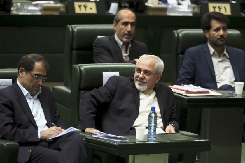 Iranian Foreign Minister Mohammad Javad Zarif, center, will be the new chief delegate to nuclear talks with both the International Atomic Energy Agency and six major powers that include the United States. Analysts saw Thursday's move by Iranian President Hassan Rouhani to take over control of the negotiations from the religious hierarchy as a sign that the new president plans to make good on a campaign promise to improve relations with the West.