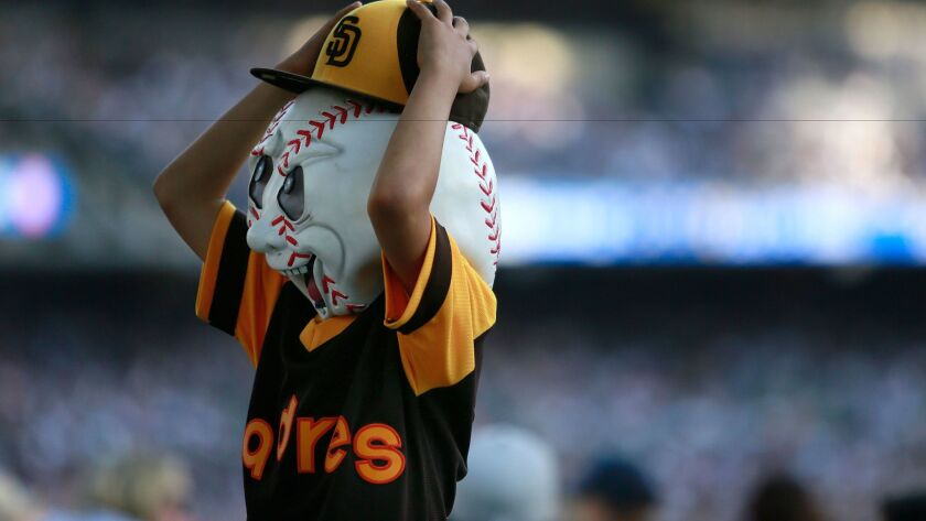 Alexis Juarez, 8, holds on to his Padres hat at Opening Day in Petco Park.