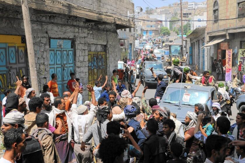 Fighters celebrate in Taizz after a battle with Houthi rebels in Yemen.