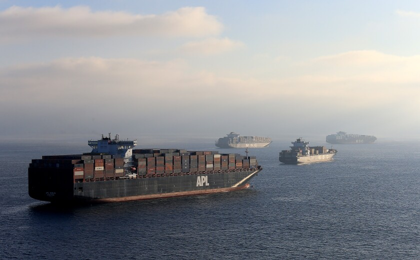 Cargo ships are in the ocean.