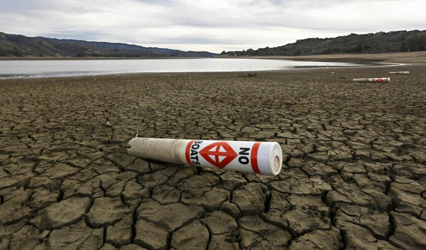 A warning buoy sits on the dry, cracked bed of Lake Mendocino near Ukiah, Calif. As bad as the drought in California and the Southwest has been, scientists say far worse historic decades-long dry spells are coming.