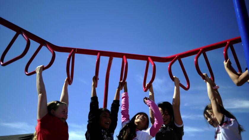 Third grade girls play on the new playground equipment at Bennett Elementary School on Thursday, September 22, 2011. Bennett is taking advantage of federal grants to help improve the physical fitnes