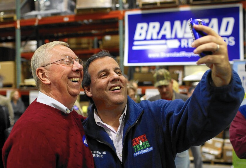 Though the election isn't until 2016, presidential hopefuls are already strategizing. New Jersey Gov. Chris Christie takes a selfie with Dick Benne of Burlington, Iowa, after speaking at a get-out-the-vote rally in October.