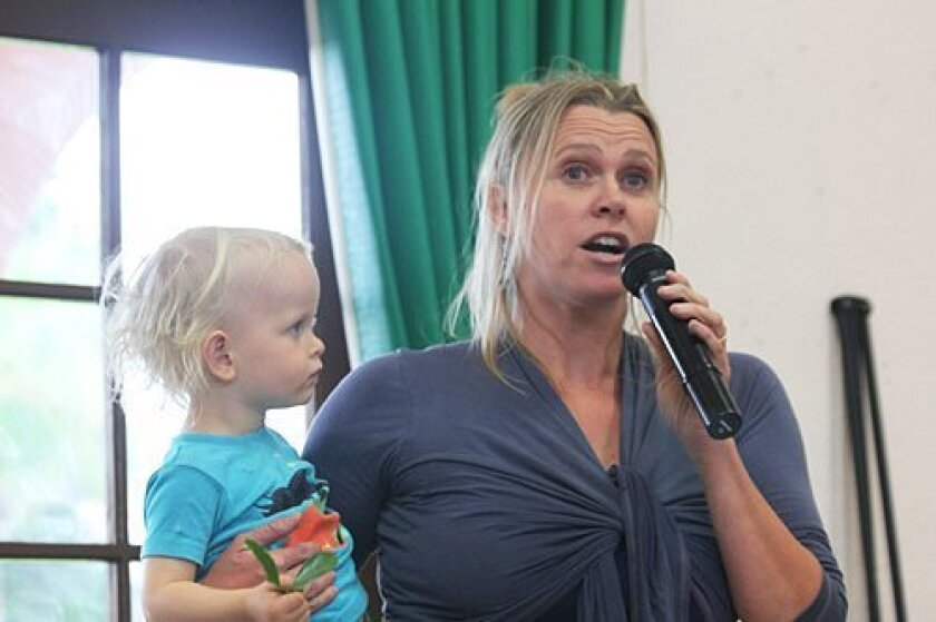 Torrey Pines elementary School parent Mary King (pictured with her son) speaks in favor of the la Jolla Community Planning Association upholding its original vote to deny a third cell phone tower at Cliffridge Park. Pat Sherman