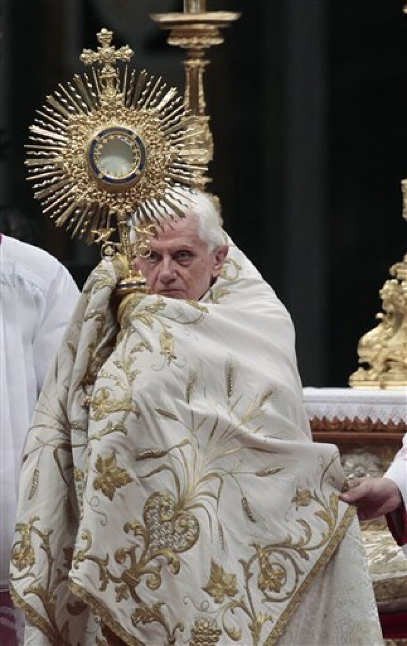 Pope Benedict XVI holds the ostensory during a Vespers prayer in St. Peter's Basilica at the Vatican, Thursday, Feb. 2, 2012. (AP Photo/Gregorio Borgia)