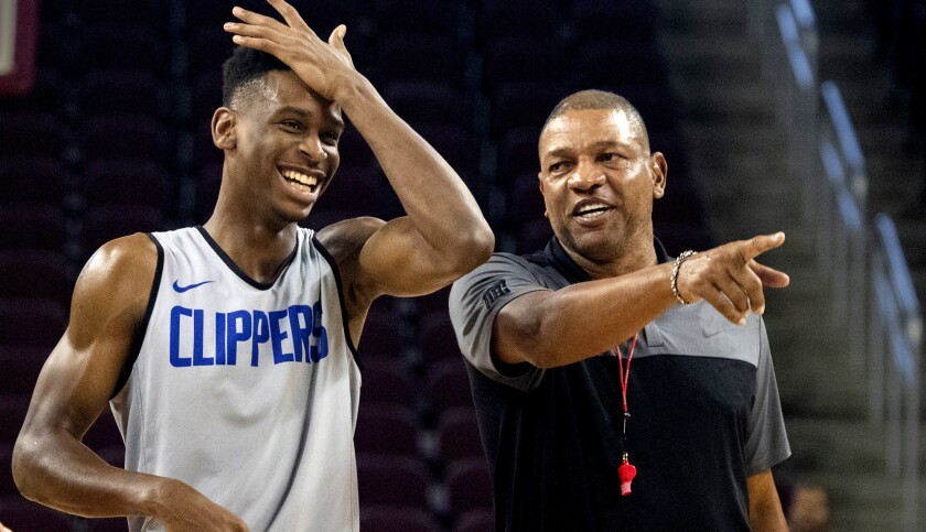 LOS ANGELES, CALIF. -- MONDAY, OCTOBER 8, 2018: L.A. Clippers coach Doc Rivers helps point guard Sha