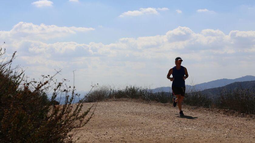 LA CANADA FLINTRIDGE FEBRUARY 28, 2018: A runner enjoys the Descanso Trail on February 28, 2018. Thi