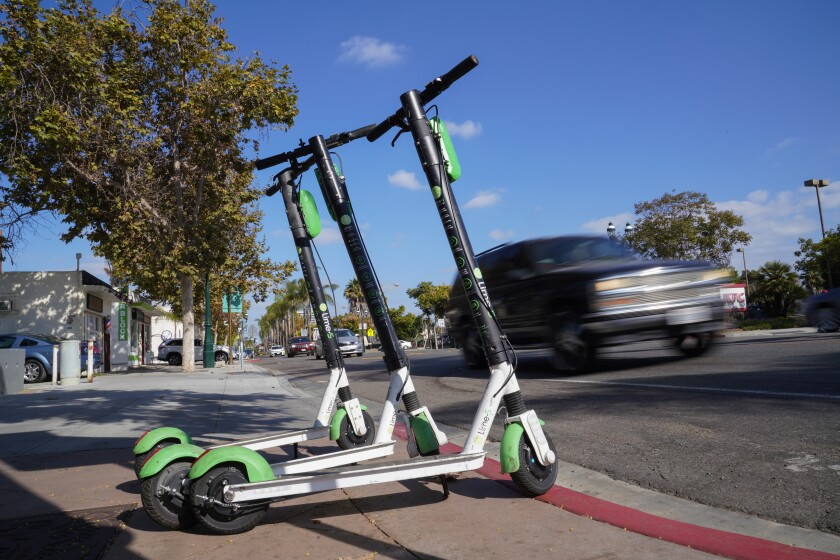 Lime scooters parked along Third Avenue in downtown Chula Vista. Lime scooters is leaving because of increased regulations in San Diego.