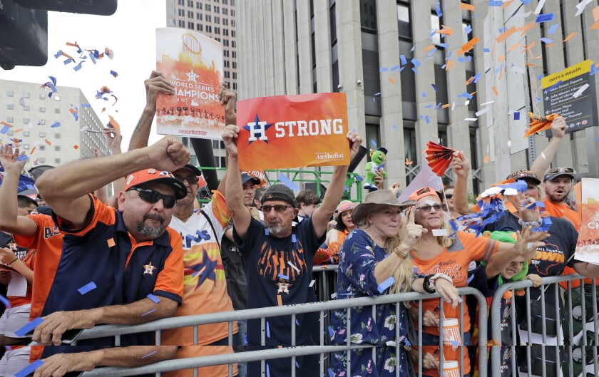 Houston Astros fans celebrate during the team's World Series title parade in November 2017.