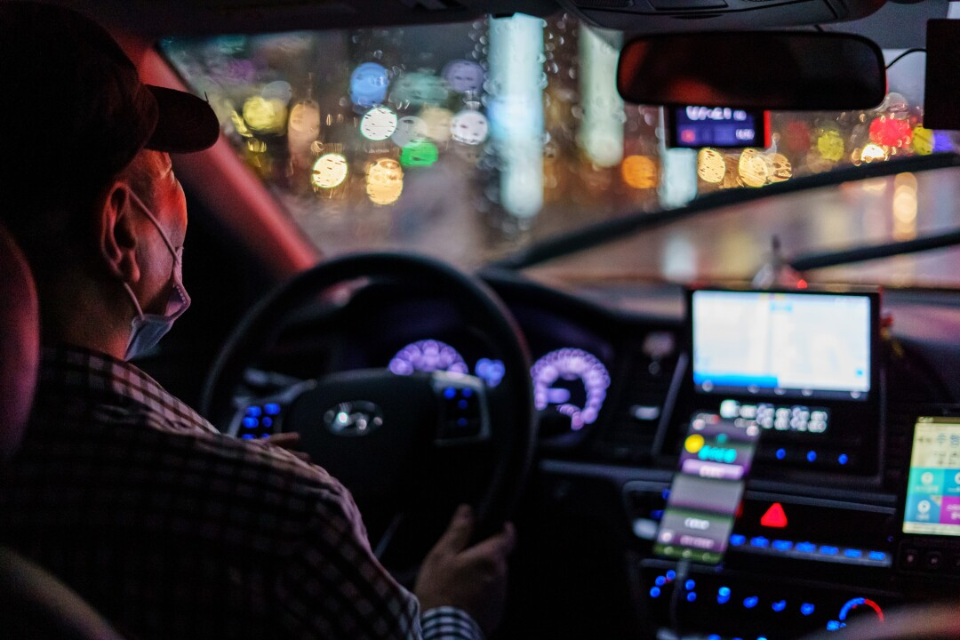 A taxi driver navigates the rainy weather during a fare in Seoul.