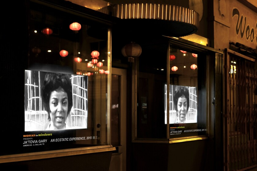 """Video artist Ja'Tovia Gary's """"An Ecstatic Experience"""" plays in a Chung King Road storefront."""