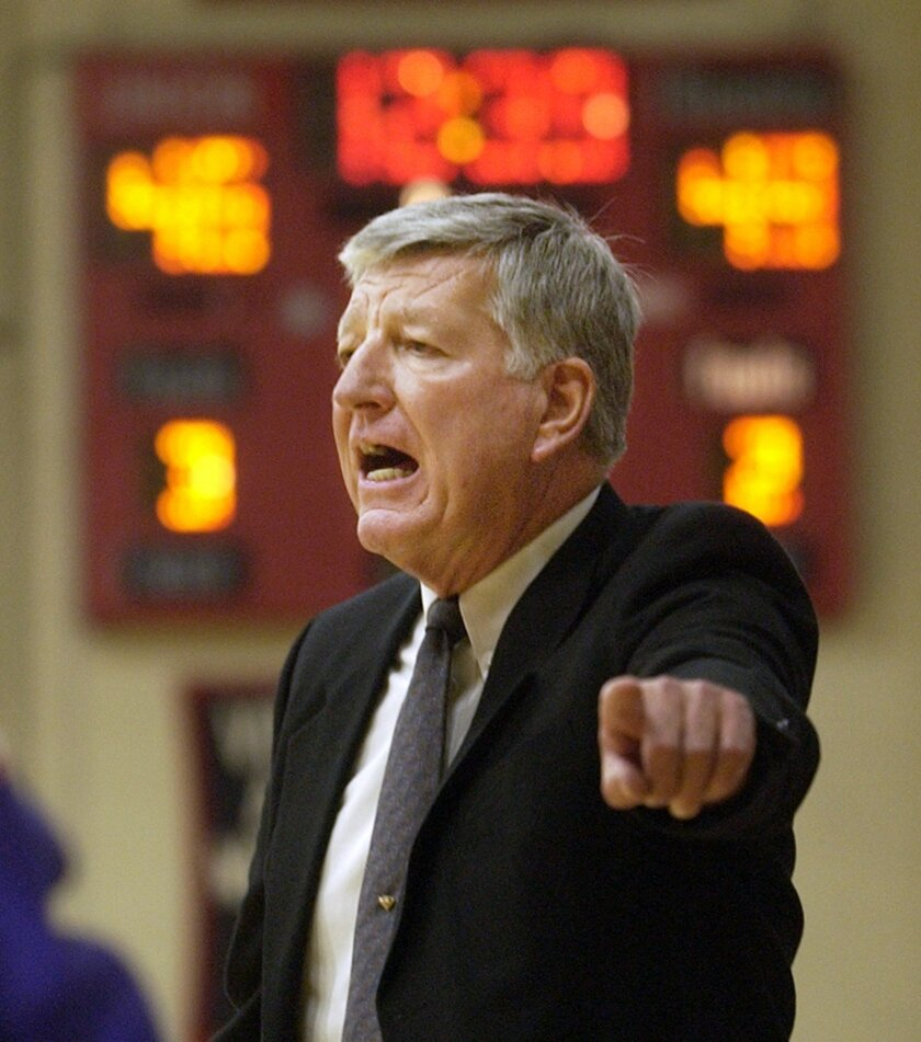 FILE - In this Nov. 27, 2004, file photo, McKendree College men's basketball coach Harry Statham directs his players to a 78-69 win over Freed-Hardeman College in Jackson, Tenn., securing his 879th victory and tying North Carolina legend Dean Smith  for career wins. Statham has won 1,088 games in 5