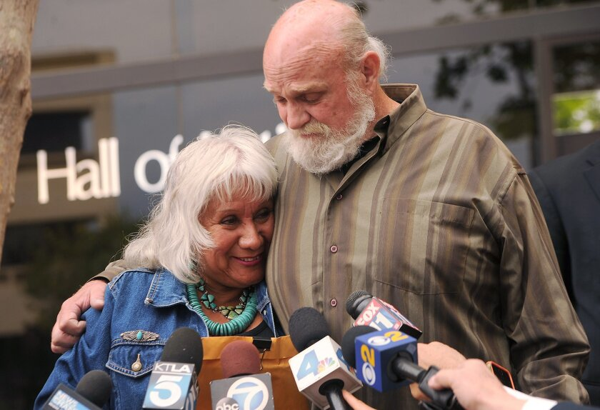Michael Hanline and his wife Sandy answer questions from the media after his case was dismissed in Ventura, Calif., Wednesday, April 22, 2015. The Southern California man who was freed after serving 34 years of a life sentence for murder had the charges formally dismissed. Hanline was the longest-s